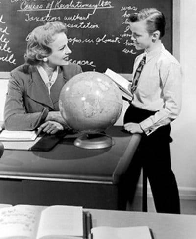 vintage boy talking with elementary school teacher