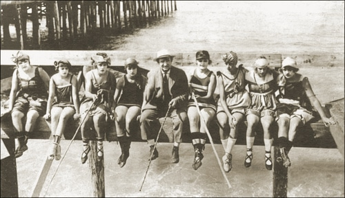 vintage group of ladies fishing off dock