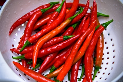 cayenne peppers in strainer colander