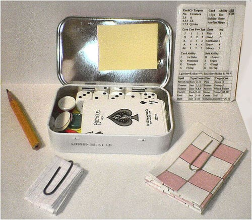 Altoids tin using for games cards and dice.
