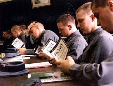 Military cadets reading howl poem in hall.