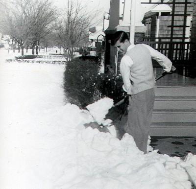 vintage man sweater vest shoveling snow tom hahn