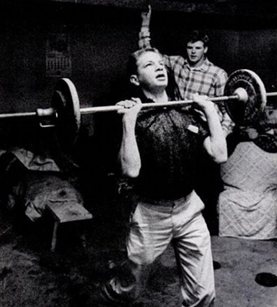 Vintage man lifting barbell weight.