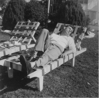 vintage man napping in lounge chair outside lawn