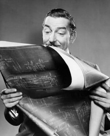 vintage man holding studying blueprints