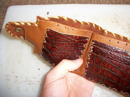 Man made a homemade leather wallet.