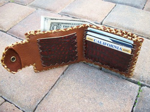 Leather wallet with credit cards and money in it.