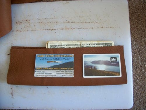 homemade leather wallet laying out size for cards cash