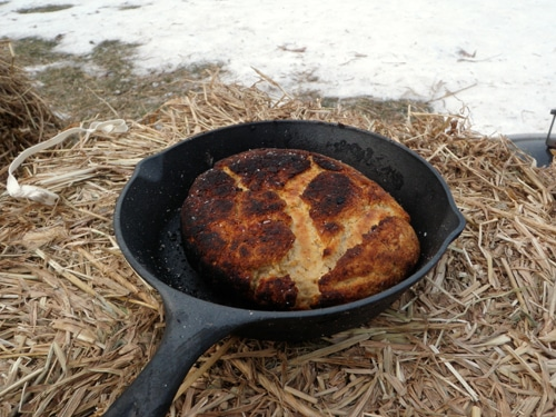Making bannock bread in iron skillet at outdoors.