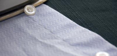 iron dress shirt under button close up ironing