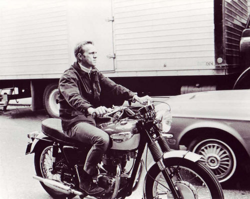 steve mcqueen on motorcycle in traffic