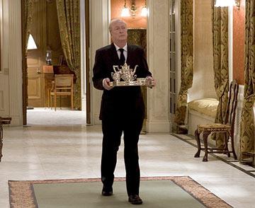 alfred butler batman waking down hallway tea tray