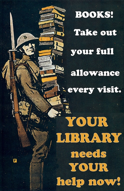 A soldier carrying library books.