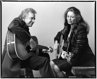 johnny and june cash older couple playing guitar together