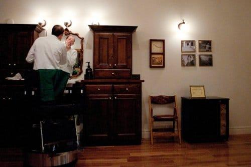 drew danburry barber in barbershop applying shaving cream