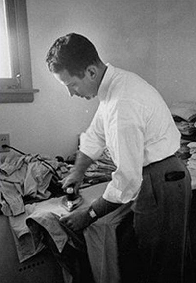 Vintage man ironing the shirts.