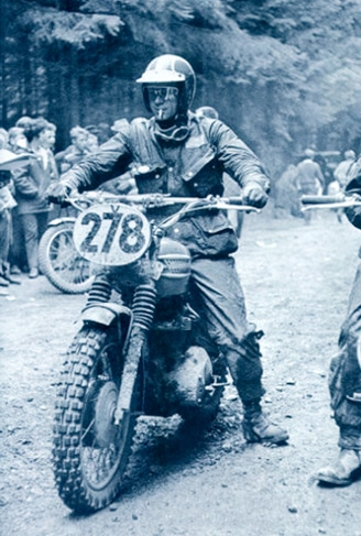 steve mcqueen on motorcycle wearing helmet cigarette