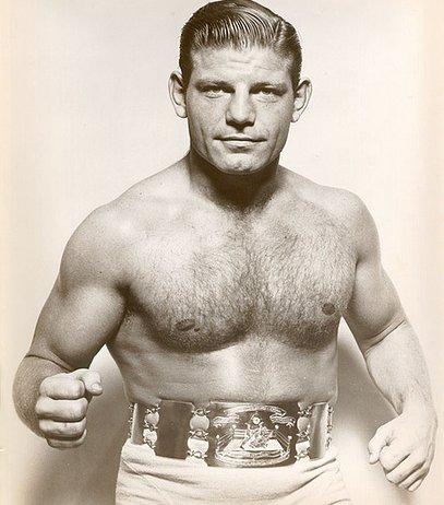 vintage wrestler boxer posing with belt