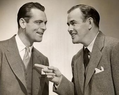 Vintage two businessmen talking conversation pointing.