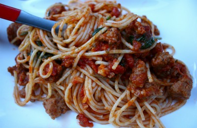 Homemade spaghetti red meat sauce close up.