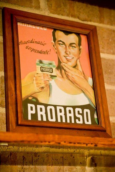 Vintage ad man holding proraso brand.
