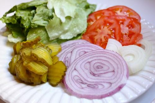 hamburger burger toppings onions lettuce pickles tomato
