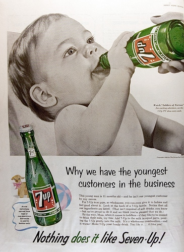 Baby drinking 7 up soda vintage ad advertisement.