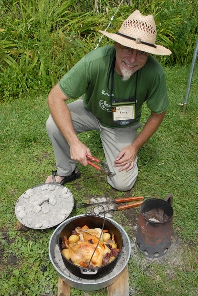 A man cooking Roast chicken in a dutch oven.