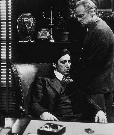 Godfather movie Marlon Brando Pacino sitting on chair.