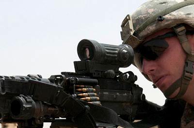 Oakley protective eye-wear on solider aiming gun