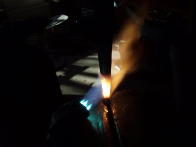 Cetylene torch in action heating metal blacksmithing.