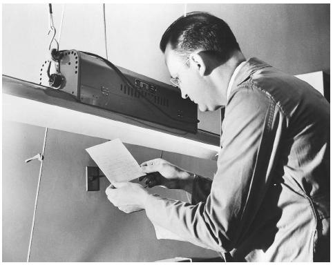 Vintage man reading a memo written with invisible ink.