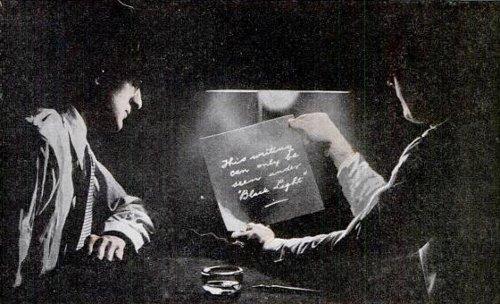vintage men feds looking reading invisible ink under light