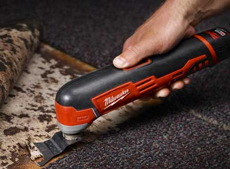 milwaukee oscillating multi-tool in use cutting flooring
