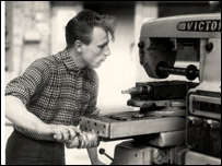 vintage men using welding machine shirt sleeves rolled up