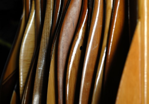 collection of canoe wooden paddles up close photo