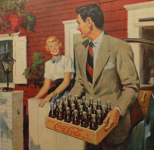 Man arriving at home with case of coca cola painting.