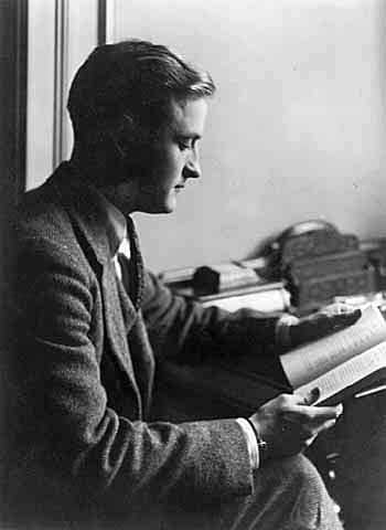young f scott fitzgerald reading in office at desk