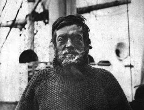 ernest shackleton chest up photo ice on beard wearing turtleneck