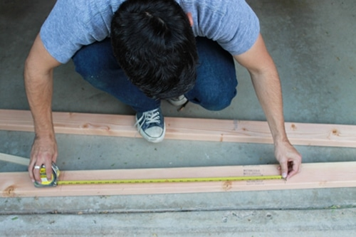 cutting measuring wood for diy homemade sawhorse