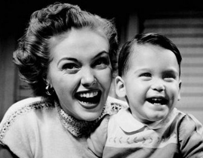 Vintage young boy smiling with his mom.
