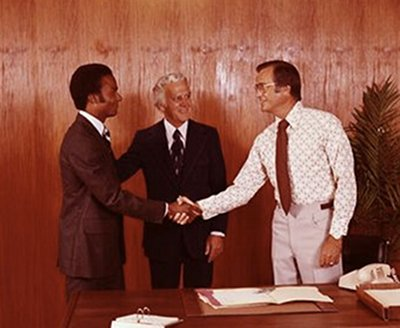 Vintage businessmen are shaking hands while making a deal.