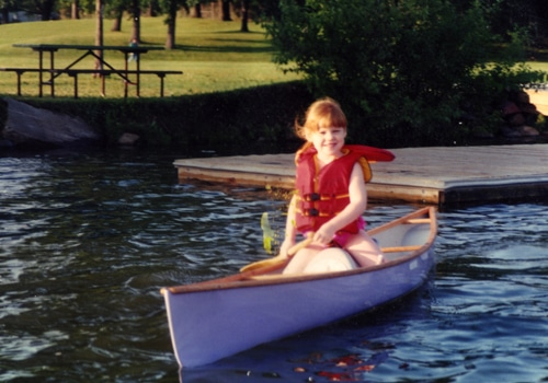 A baby girl in the boat.