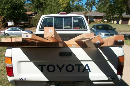 wood lumber pieces in back of toyota truck