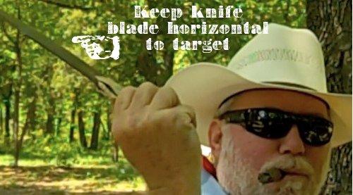 Man throwing knife blade horizontal to the target.