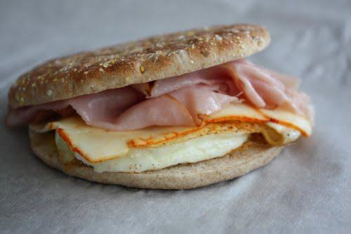 breakfast sandwich egg cheese ham thin bread slices