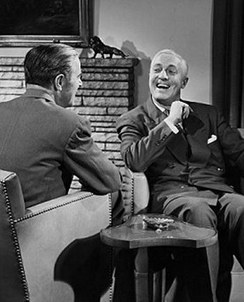 vintage men talking laughing across from each other