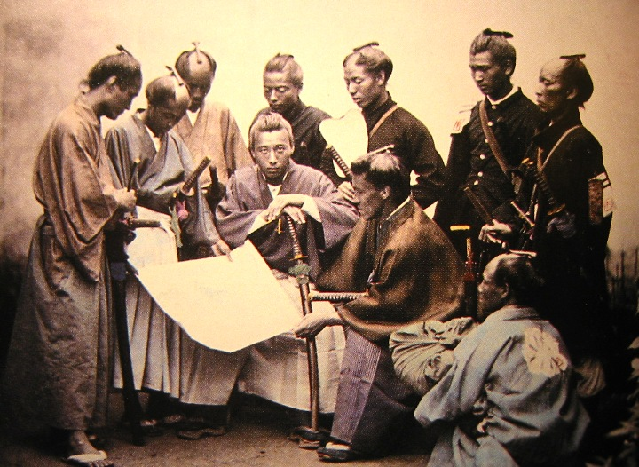 samurai warriors gathered in group going over plans