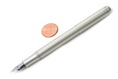 Fountain pen with coin.