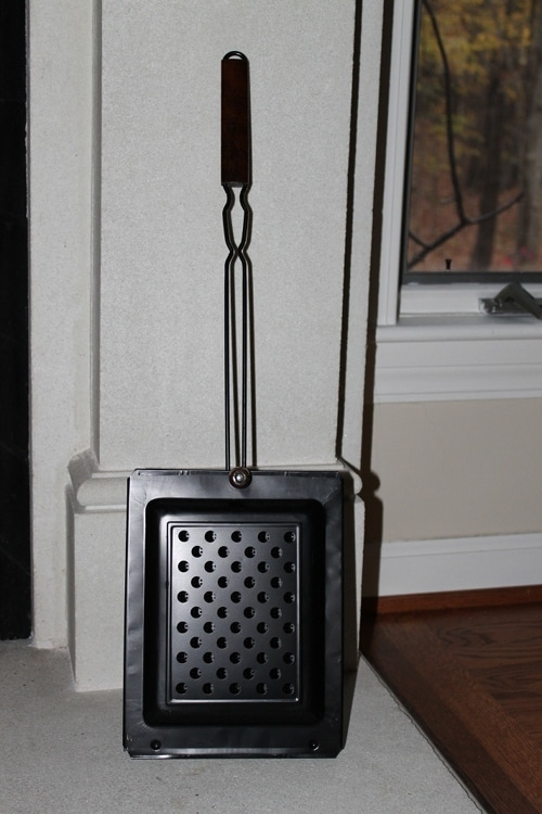 chestnut roaster for cooking nuts over fire fireplace